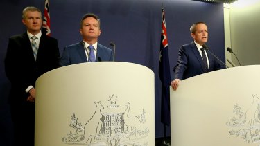 Opposition Leader Bill Shorten during a joint press conference with shadow treasurer Chris Bowen and finance spokesman Tony Burke on Friday.