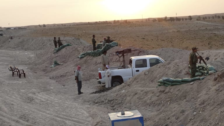Determined resistance: Tribal fighters dig in against Islamic State militants in the town of Amriyat al-Falluja in Anbar province.