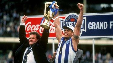 Denis Pagan and Wayne Carey hold the 1996 premiership cup aloft.