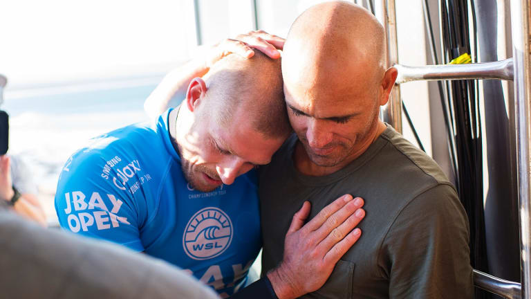 Mick Fanning of Australia (pictured blue) is hugged by Kelly Slater (US) after being attacked by a shark during the final of the JBay Open on Sunday.