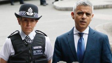 Mayor of London Sadiq Khan (right) talks to reporters alongside London Police Commissioner Cressida Dick (left).