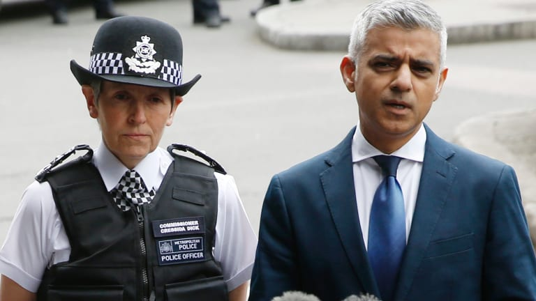 Mayor of London Sadiq Khan (right) talks to reporters alongside London Police Commissioner Cressida Dick (left).