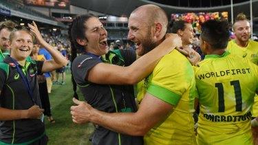 Charlotte Caslick congratulates Australian men's sevens veteran Chucky Stannard on their 2018 Sydney Sevens win.