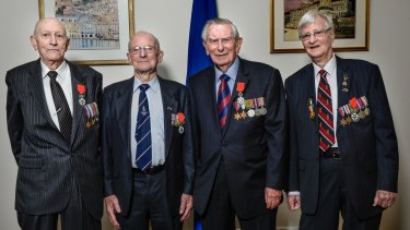 Australian WWII veterans Ronald Cleaver, Donald McDonald, James Coulter and Denis Kelly receive the Legion d'Honneur from France for their service.
