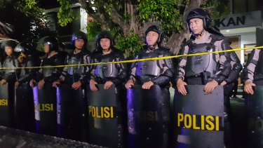 Riot police gather outside Kerobokan prison for the transfer.