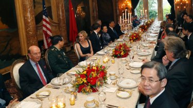 President Donald Trump and Chinese President Xi Jinping, with their wives seated at the centre, during a dinner at Mar-a-Lago.