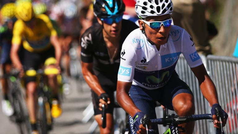 Richie Porte (C) shadows Nairo Quintana (R) as he attacks race leader Chris Froome (L) on the Alpe d'Huez.