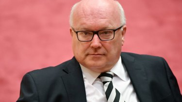 """MPs who can """"honestly swear"""" they didn't know they were dual citizens should be ruled eligible, George Brandis told the High Court."""