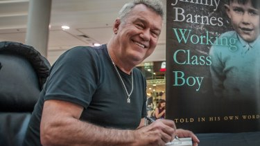 Rock legend Jimmy Barnes signs copies of his autobiography <i>Working Class Boy</i>.