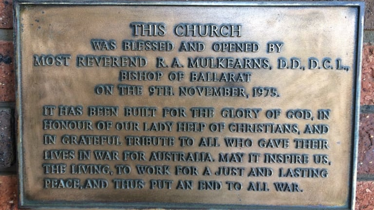 A plaque on the Our Lady Help of Christians church in Warrnambool