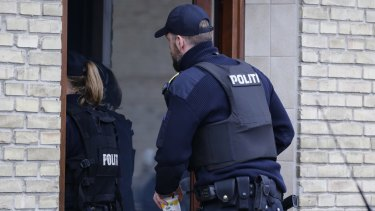 Danish Police search an apartment in Tingbjerg, Copenhagen, on Thursday.