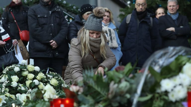 Mourners lay flowers and candles at a makeshift memorial near the site of the attack.