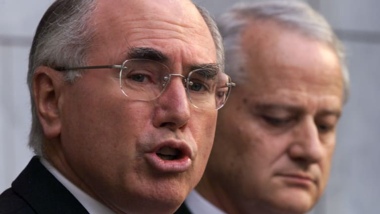 John Howard and Phillip Ruddock, his Immigration Minister,during a press conference on the Kosovo crisis and refugees.