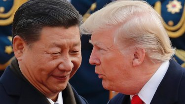 US President Donald Trump, right, chats with Chinese President Xi Jinping.