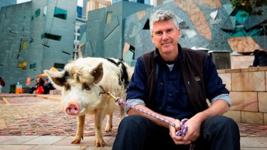 Matthew Evans and piggy friend at Federation Square in Melbourne.