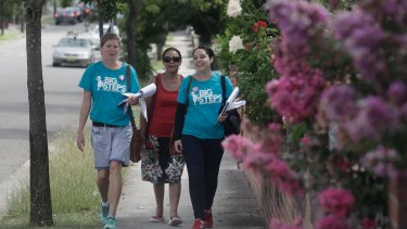 Mel Gatfield, Assistant Secretary of NSW Branch United Voice (left), with early childhood teacher Brigitte Mitchell (right) and her mother in Burwood on Saturday. They were door knocking to raise support for higher wages.