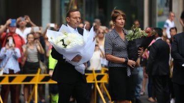 """I'll be doing more"": Prime Minister Tony Abbott and his wife Margaret arrive at Martin Place on Tuesday to pay their respects."
