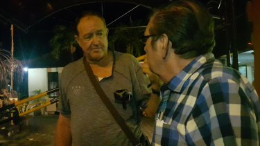 Garry Croker (left), a friend of the victim, outside South Denpasar police station after giving his statement.