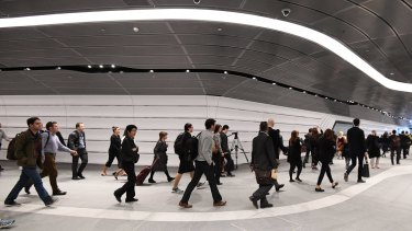 Commuters file through the new tunnel for the first time on Tuesday.