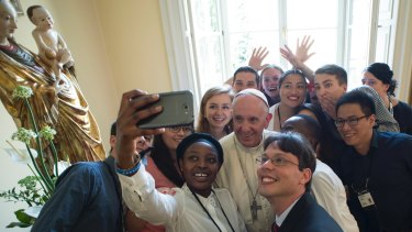 Pope Francis poses for a selfie after having lunch with young people at the Bishop's residence in Krakow, Poland, for World Youth Day last year.