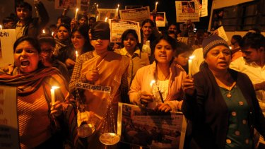 Indians take part in a candlelight vigil for a victim of gang rape in New Delhi, India,  January 13, 2013. .