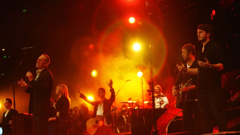 Brian Houston (left) leads the Hillsong entourage at the church's annual conference in Sydney.