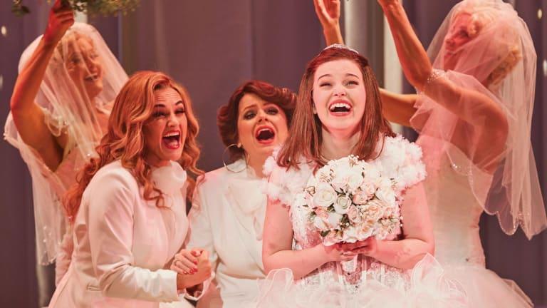 Maggie McKenna's bridal shop scenes are dazzlingly funny.