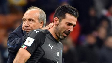 Legend: Gianluigi Buffon is comforted by Gian Piero Ventura after the final whistle.