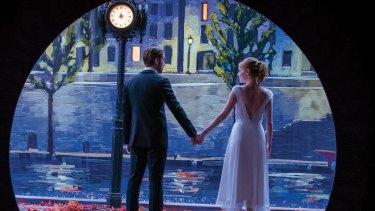Sebastian (Ryan Gosling) and Mia (Emma Stone) light up the screen in <i>La La Land</i>.