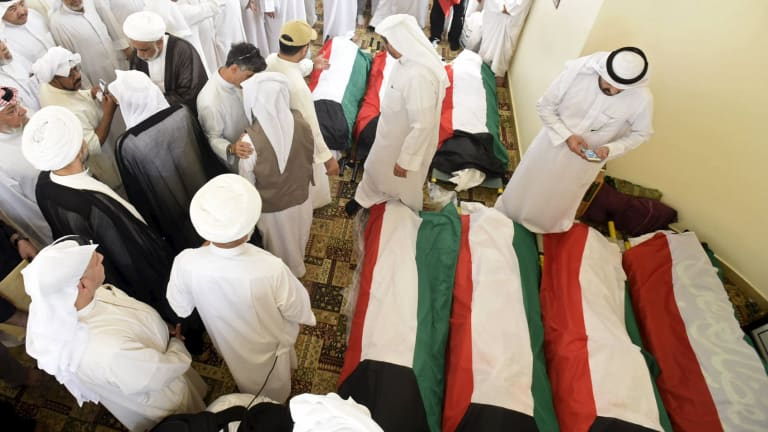 Kuwait flags are draped over bodies of the victims of the mass mosque terror attack.