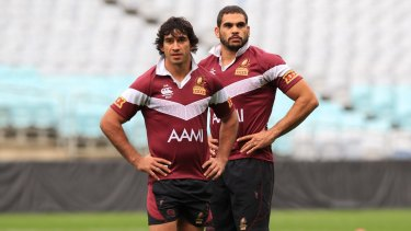 Johnathan Thurston and Greg Inglis in training with the Queensland Maroons in 2012.