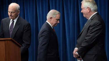 From left, Homeland Security Secretary John Kelly, Attorney-General Jeff Sessions and Secretary of State Rex Tillerson, take turns speaking at the launch of the revised travel ban.
