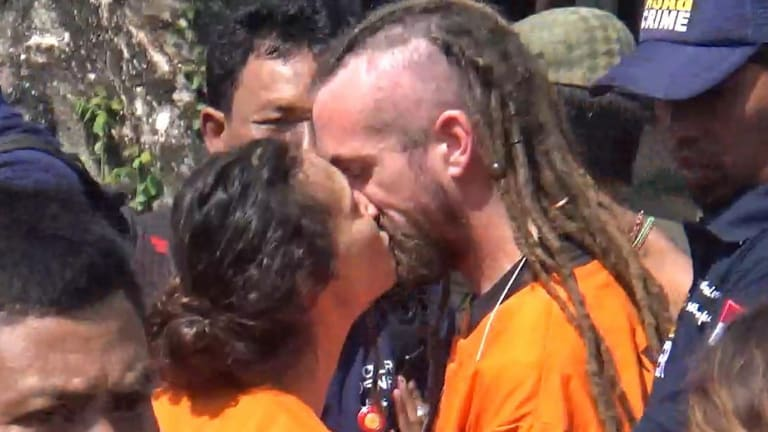 Sara Connor and David Taylor kiss in August during a police re-enactment of the events that led to the death of Wayan Sudarsa.
