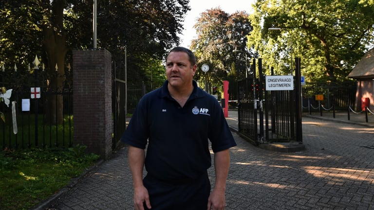 Senior Sergeant Rod Anderson at the front gates of the Hilversum military base, where the bodies of the MH17 victims were brought once they landed in the Netherlands.
