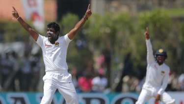 Sri Lanka's bowler Dilruwan Perera (left) successfully appeals to dismiss Australia's David Warner.
