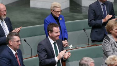 Former speaker Bronwyn Bishop holds her hands as other MPs applaud the election of Tony Smith as her replacement on Monday.