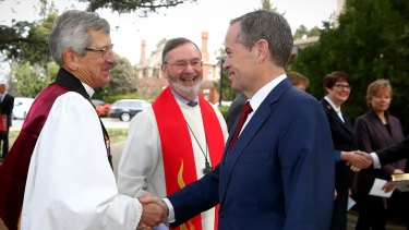 Opposition Leader Bill Shorten is welcomed to the Ecumenical Service to mark the opening of the 45th Parliament at the Church of St Andrew in Canberra. The same-sex marriage confrontation occurred after the ceremony.