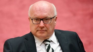 Attorney-General George Brandis argues that a person who is ignorant of their status as a dual citizen should not be disqualified