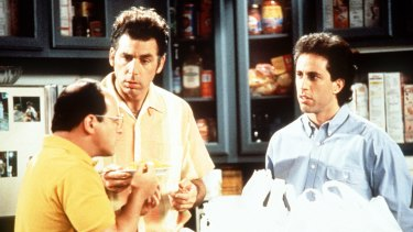 From left, Jason Alexander, Michael Richards and Jerry Seinfeld in a scene from <i>Seinfeld</i>.