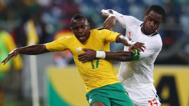 Dogged defender: Jacques Faty (right) battles for the ball with South Africa's George Maluleka during an international friendly at Moses Mabhida Stadium in Durban.