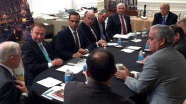 In this photo from President Donald Trump's Twitter account, George Papadopoulos, third from left, sits at a table with then-candidate Trump and others at what is labeled at a national security meeting in Washington in 2016.