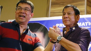 """Mayor Rodrigo Duterte, right,  is officially declared the presidential candidate of the PDP-Laban political party by its president, senator Aquilino """"Koko"""" Pimentel, in November last year."""