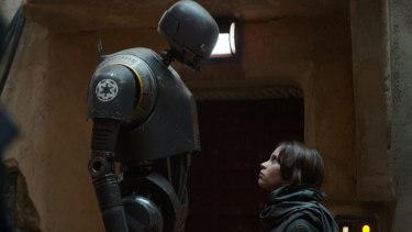 Alan Tudyk as K-2SO (left) and Felicity Jones as Jyn Erso in a scene from <i>Rogue One: A Star Wars Story</i>.