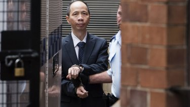 """Lian Bin """"Robert"""" Xie leaves the Supreme Court on Tuesday after being granted bail."""