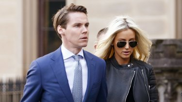 Oliver Curtis with wife Roxy Jacenko arrives at St James Supreme Court on Wednesday for his insider trading trial.