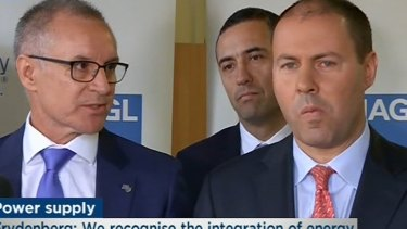 South Australia Premier Jay Weatherill takes a rare glance at Energy Minister Josh Frydenberg during the tense exchange.
