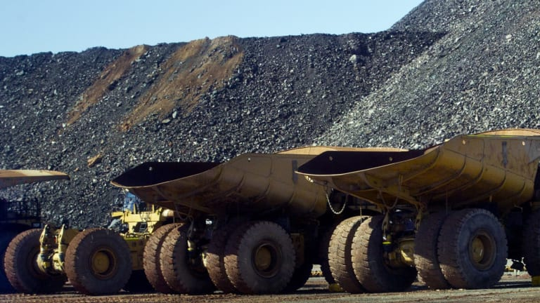Queensland Mines Minister has poured cold water on the suggestion Adani's Galilee Basin coal mine will receive approval soon after an EA was issued this week.