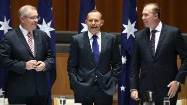 Mr Morrison, Mr Abbott and Mr Dutton laugh at the joke.