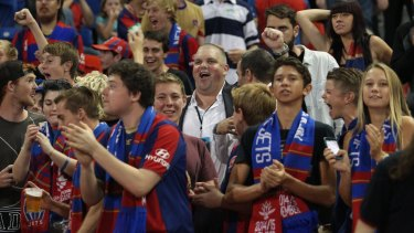 Punters pal: Nathan Tinkler with Newcastle Jets fans last Friday night.