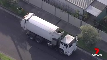 The driver of this garbage truck discovered the body.